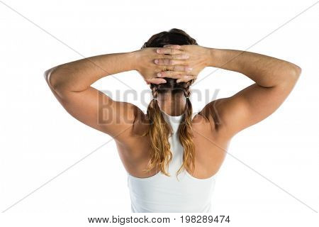 Rear view of rugby player with hands behind head against white background