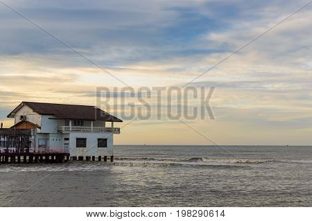 House On Stilts In The Sea On Sunrise In Thailand