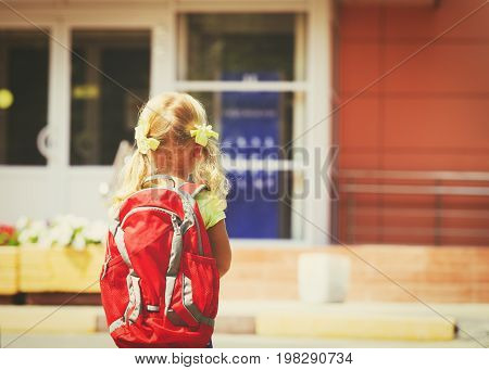 Back to school concept - little girl goes to preschool or daycare