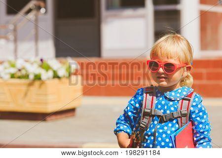 Back to school - cute little girl near preschool or daycare