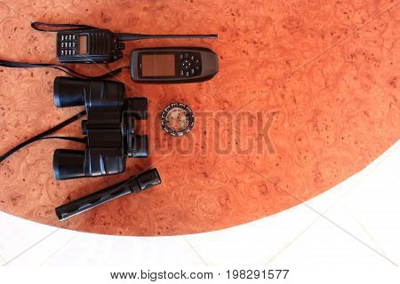 Equipment for communications and rescue on the table.
