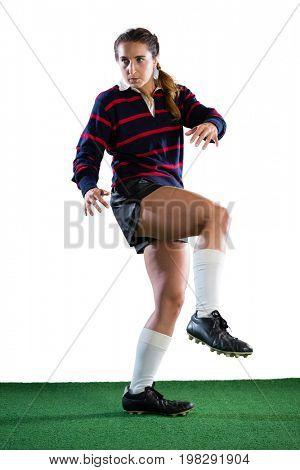 Full length of female player on field against white backgrond