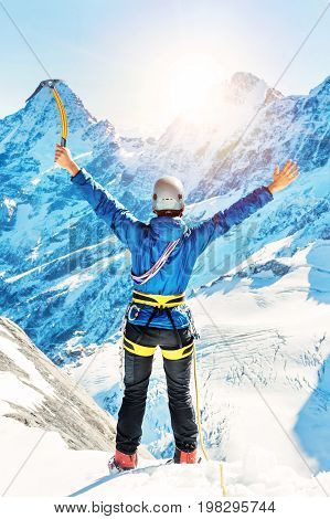 Climber reaches the top of mountain peak. Climbing and mountaineering sport. Nepal mountains.