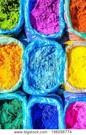 Colorful powder for sale on the festive occassion of Holi in India. Colorful Indian powder background