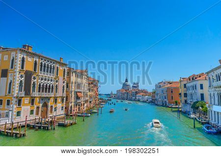 Famous view on Grand canal and Santa Maria della Salute Cathedral from Accademia Bridge in Venice, Italy.