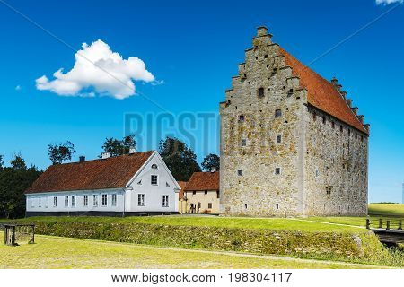 An image of the medieval glimmingehus castle in the skane region of Sweden.