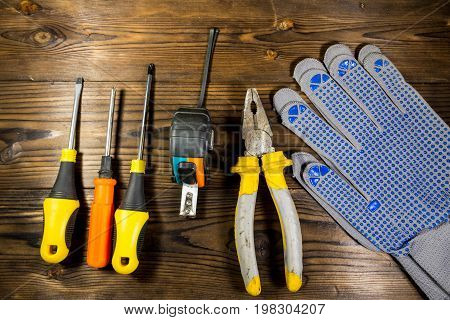Set Of Work Tools On Wooden Background