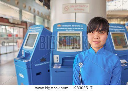 HANOI, VIETNAM - MAY 11, 2015: indoor portrait of a worker at Noi Bai International Airport