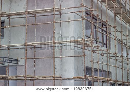 Building Covered With Scaffolding At Construction Site 2
