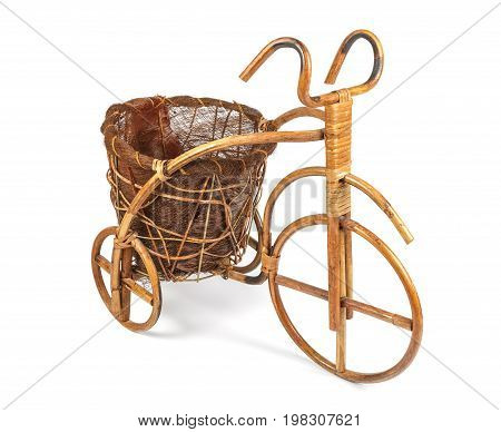 Flower stand in the form of a bicycle made from rattan. Right view