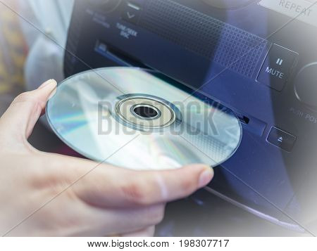 Car's driver insert CD DVD in to car audio player