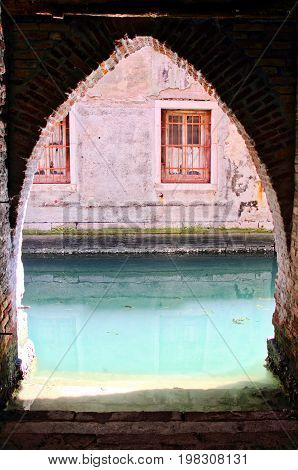 An entryway on one of the canals of Venice.