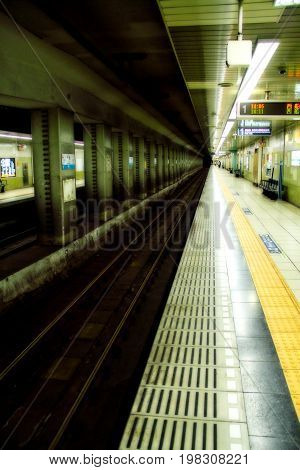 An image of a Tokyo train station nearly empty of commuters.