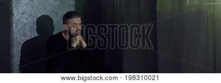 Sad Man Sitting Beside Wall
