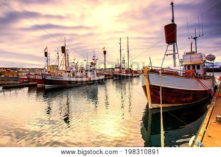 Traditional Fisherman Boats Lying In The Harbor Of Husavik