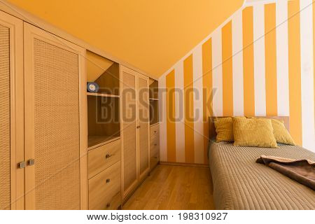 White And Orange Bedroom With Small Bed
