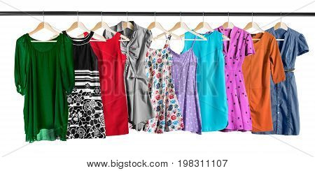 Dresses and sundresses hanging on clothes racks isolated over white