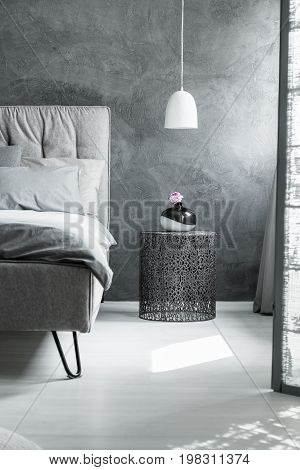 Interior With Openwork Bedside Table