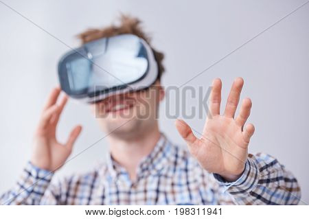 Male Immersed In Virtual Reality