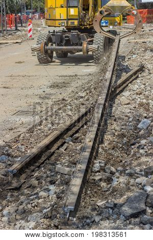 Arm And Claw Of An Excavator Resemble Tram Tracks