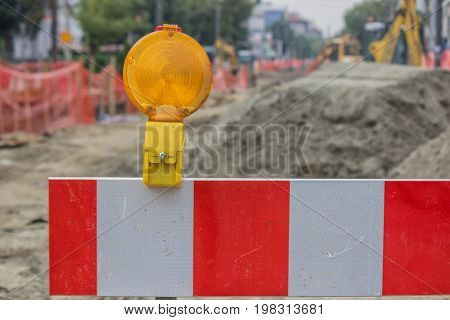 Construction Barrier Sign With Yellow Warning Ligh