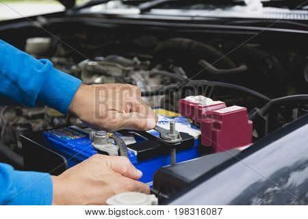 Hand of technician checking engine of car. Auto mechanic checking car engine. Maintenance checking car.