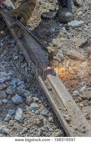 Welder Using Oxyacetylene Cutting Torch To Cut Old Tram Tracks