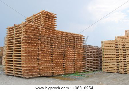 wood pallets stack shipping transport industry warehouse platform