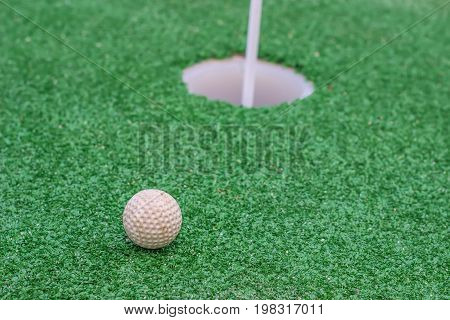 White Golf Ball On Golf Course