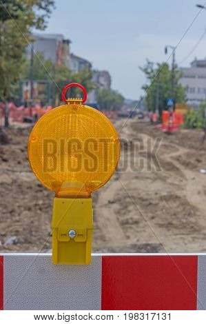 Yellow Warning Ligh On Construction Barrier Sign