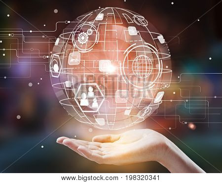 Hand holding digital globe with business icons on blurry background. Technology and interface concept. 3D Rendering