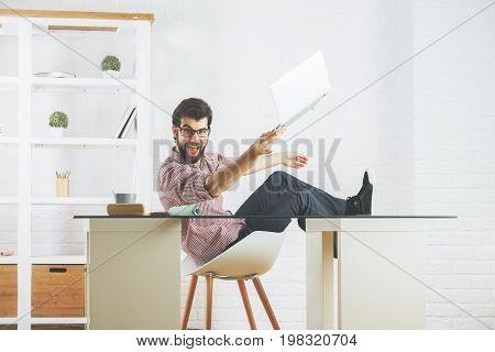 Mad Man Breaking Laptop