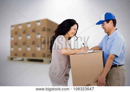 Woman signing for a package against grey background