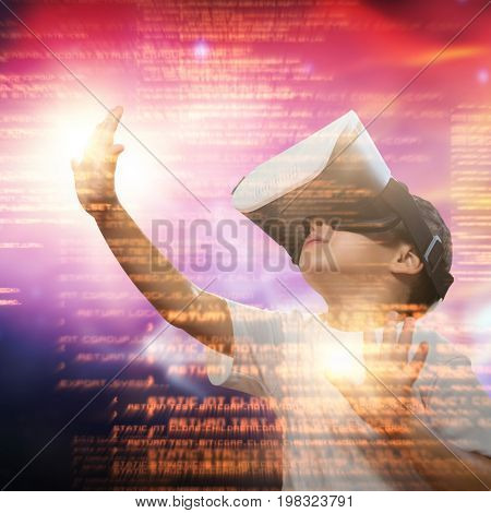 Boy using virtual reality simulator glasses against vector image of illuminated orange light