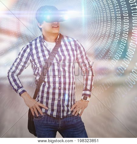 Young man with hand on hop wearing virtual reality simulator glasses against spiral of shiny binary code