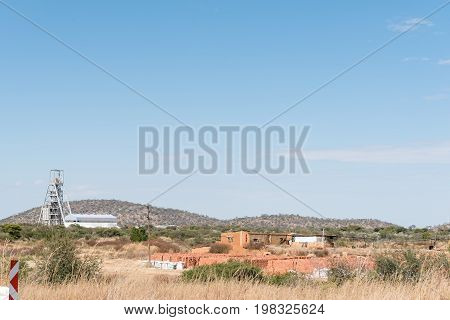 The headframe at the copper mine and a ruin at Kombat in the Otjozondjupa Region of Namibia