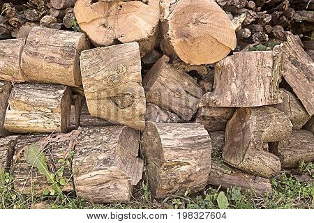 Close up of chopped firewood. Firewood stacked and prepared for winter Pile of wood logs
