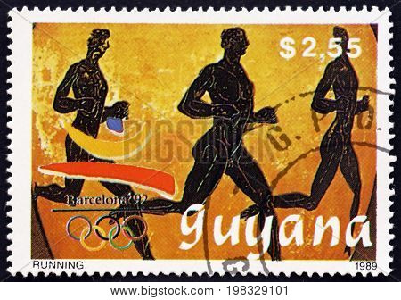 GUYANA - CIRCA 1989: a stamp printed in Guyana shows Running 1992 Summer Olympics Barcelona circa 1989