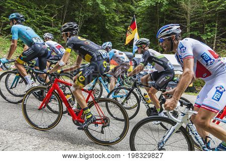 Mont du Chat France - July 9 2017: Detail image of a group of cyclists in the peloton climbing the road on Mont du Chat during the stage 9 of Tour de France 2017.