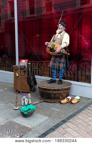 August 4th, 2017, Cork, Ireland - street performer on St. Patrick street