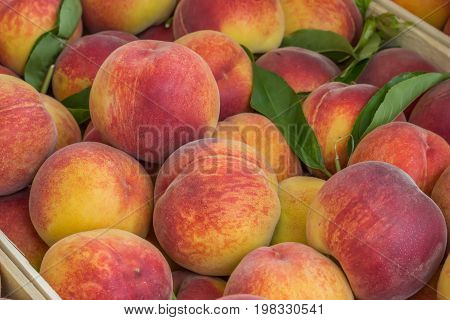 Farmers Market Peaches In A Wooden Crate Background