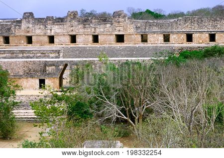 Nunnery Quadrangle building with trees in Uxmal Mexico