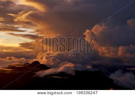 Sunrise on the top of Mount Adam Peak. Rising of the sun on Sri Pada - Sri Lanka. The mountain of butterflies.  Background for poster. October.