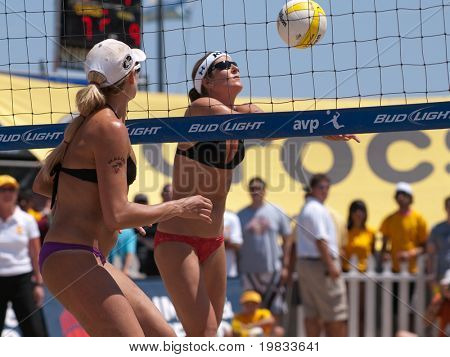 HERMOSA BEACH, CA. - AUGUST 8: Jen Kessy (L) and April Ross vs. Nicole Branagh (R) and Elaine Youngs for the womens final of the AVP Hermosa Beach Open. August 8, 2009 in Hermosa Beach.