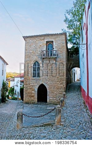 The stone Synagogue of Obidos is one of the oldest in world it's located in Jewish Quarter of the old town-fortress Portugal.