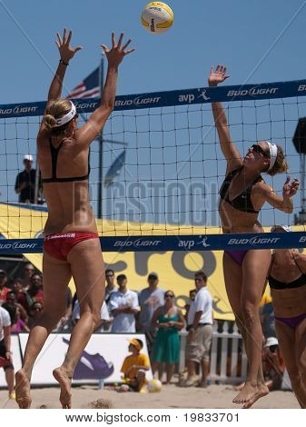 HERMOSA BEACH, CA. - AUGUST 8: Jen Kessy and April Ross (R) vs. Nicole Branagh (L) and Elaine Youngs for the womens final of the AVP Hermosa Beach Open. August 8, 2009 in Hermosa Beach.