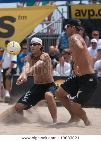 HERMOSA BEACH, CA. - AUGUST 9: Phil Dalhausser and Todd Rogers vs. John Hyden (L) and Sean Scott (R for the mens final of the AVP Hermosa Beach Open. August 9, 2009 in Hermosa Beach.