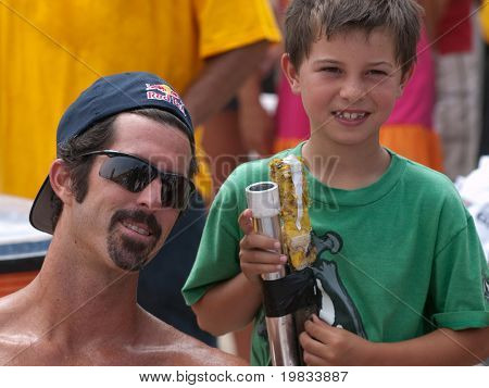 HERMOSA BEACH, CA. - AUGUST 9: Todd Rogers and his son Nate Rogers after the mens final of the AVP Hermosa Beach Open. August 9, 2009 in Hermosa Beach.
