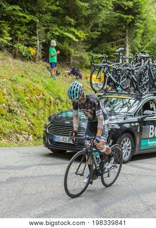 Mont du Chat France - July 9 2017: The Polish cyclist Rafal Majka of Team Bora-Hansgrohe suffering after an earlier crash is climbing the road on Mont du Chat during the stage 9 of Tour de France 2017.