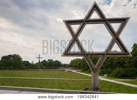 Terezin Czech Republic - July 5 2017: David's star at Terezin memorial and cemetery. Thousands of Jew people were murdered in the concentration camp Small Fortress by Nazis during WW2.